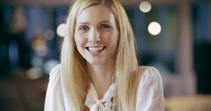Blonde woman smiling to camera portrait. Corporate business team work office meeting. Caucasian businessman and stock footage