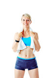 Blonde woman smiling to the camera wearing sports wear and holding white towel Royalty Free Stock Photography