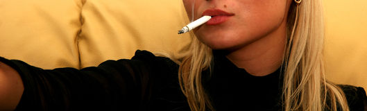 Blonde Woman Smoking Royalty Free Stock Photography