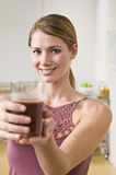 Blonde woman with smoothie. Royalty Free Stock Image