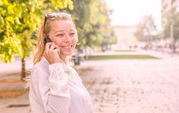 Blonde woman speaking on the phone Royalty Free Stock Photo
