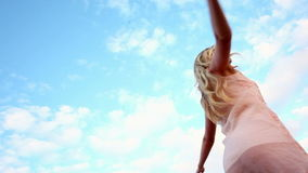 Blonde woman spinning joyfully stock footage
