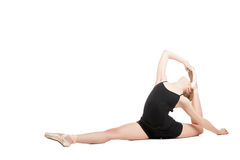 Blonde woman in split bending back Royalty Free Stock Images
