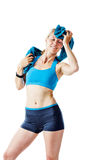 Blonde woman in sports wear drying herself with a blue towel Stock Photo