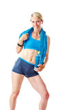 Blonde woman in sports wear holding water bottle and blue towel Royalty Free Stock Photography