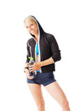 Blonde woman in sports wear holding a water bottle and smiling to the camera Stock Images