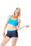 Blonde woman in sports wear smiling Royalty Free Stock Photography