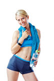 Blonde woman in sports wear smiling to the camera holding a water bottle and blue towel Royalty Free Stock Images