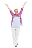 Blonde woman standing with hands up in air Royalty Free Stock Photos