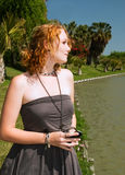 Blonde woman stands near water Stock Photography