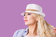 Blonde woman in straw hat stock photos