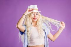 Blonde woman in straw hat royalty free stock images