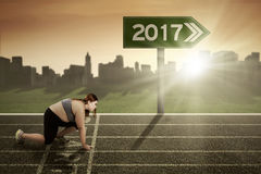 Blonde woman on street with number 2017 Stock Photos