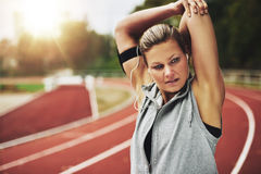 Blonde woman stretching her arms before training Royalty Free Stock Photos