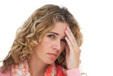 Blonde woman suffering with headache and holding her head Stock Images