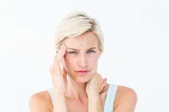 Blonde woman suffering from headache and neck ache Stock Images