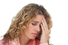 Blonde woman suffering with headache thus holding her head Stock Photo