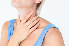 Blonde woman suffering from throat pain Stock Photography