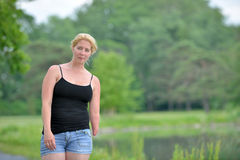 Blonde woman on a summer stroll Stock Photos