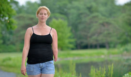 Blonde woman on a summer stroll Stock Photo