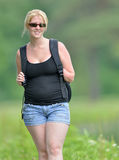 Blonde woman on a summer stroll Stock Image