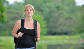 Blonde woman on a summer stroll Royalty Free Stock Photo