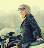 Blonde woman in sunglasses on a sports motorcycle Royalty Free Stock Photo