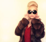 Blonde woman in sunglasses wearing mink fur coat Royalty Free Stock Photo