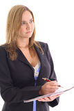 Blonde woman taking notes looking away Stock Photography