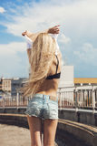 Blonde woman taking off  t-shirt Royalty Free Stock Photography