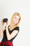 Blonde woman taking pictures with digital camera Stock Photo