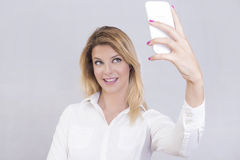 Blonde woman taking a selfie Royalty Free Stock Images