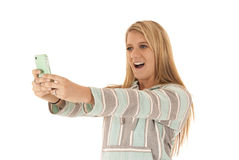 Blonde woman talking cell phone picture of herself Stock Image
