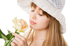 Blonde woman with tea rose Royalty Free Stock Photo
