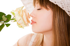 Blonde woman with tea rose Stock Photo