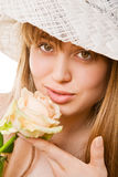 Blonde woman with tea rose Royalty Free Stock Photography
