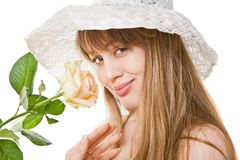 Blonde woman with tea rose Stock Images