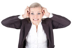 Blonde woman tearing her hair Royalty Free Stock Image