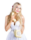 Blonde woman with telephone Royalty Free Stock Image