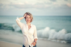 Blonde woman th the beach in summer Royalty Free Stock Images