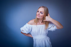 Blonde woman of about thirty in a white dress Stock Photography