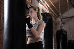 Blonde woman training boxing Royalty Free Stock Photo