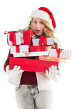 Blonde woman in trouble holding pile of gifts Stock Photo