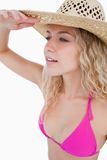 Blonde woman trying to look far to the side Stock Photos
