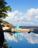 Blonde woman in turquoise long dress at the beach, Seychelles Royalty Free Stock Photography