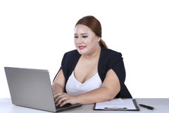 Blonde woman typing on laptop Royalty Free Stock Photography