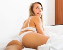 Blonde woman in underwear posing stock images