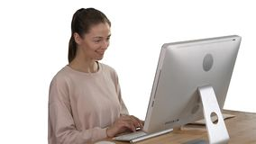 Blonde woman using computer and having an idea smiling on white background. stock video footage