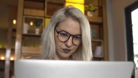 Woman using laptop. Blonde woman using a laptop stock footage