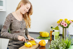 Blonde woman using a tablet computer to cook Stock Photos